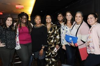 UFT Vice President for Elementary Schools Karen Alford (third from left) greets