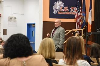 UFT President Michael Mulgrew addresses staff members at IS 72 on Staten Island