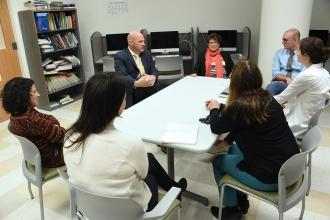 UFT President Michael Mulgrew (back, left) meets with Beacon HS staff to discuss