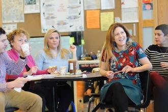 Sheri Silverstein (right), a teacher, sits with her colleagues and listens to Mi