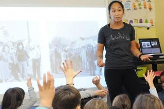 Sharon Rauceo, a 1st-grade teacher, leads her students during a history lesson a