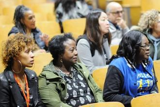 People listening intently in an auditorium