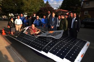 Michael Mulgrew sits inside solar car
