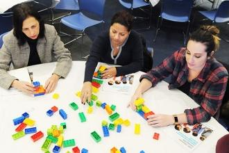 Participants work on a project with Duplo bricks during the Early Childhood LEGO