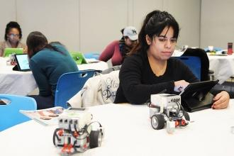 Thania Ramirez, a teacher at Creston Academy in the Bronx, programs an EV3 Minds
