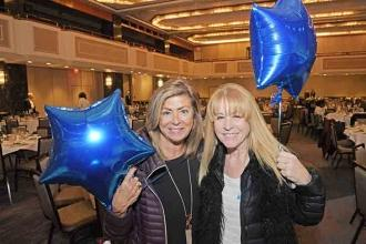 Joan Franzese (left) and Hadassah Rosenman show off the balloons they received a