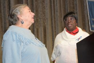Rosalie Hollingsworth and Delores Johnson sing the national anthem.