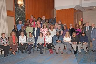 Retired elementary school chapter leaders pose with UFT officers.