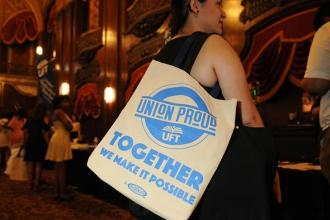 A new teaching fellow carries a UFT bag she received at the event.