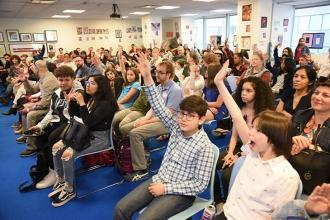 Students raise questions for the young artists who won awards at the ceremony.