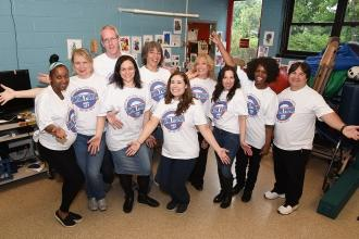 The staff at PS 721 on Staten Island show their pride and support.