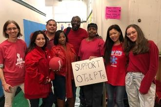 The staff of PS 363 in Manhattan wore red to show their support for occupational