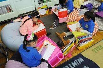 Floor cushions and lap desks in Melissa Noble's 2nd-grade classroom at the Bronx