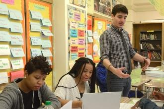 "First-year history teacher Michael Liegey (standing) says: ""I know I have my own"