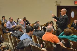 UFT President Michael Mulgrew addresses school staff during a visit to Richmond