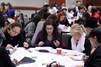 Educators focus on an exercise in the UFT Teacher Center workshop on understandi