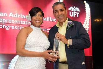 Chapter Chair Tammie Miller presents an award to Congressman Adriano Espaillat,