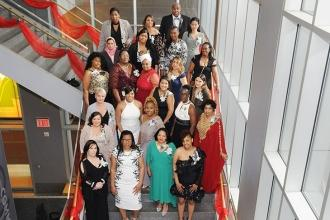 Chapter Chair Tammie Miller (third row, second from left, in white) and Vice Cha