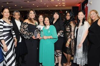 Community Champion Award winners Miguelina Suarez (third from left) and Luz Fern