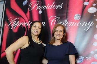 Caridad Garcia (left) and Mariluz Madera, providers from the Bronx, take a shot