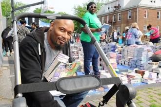 Paul Hunter, a teacher at PS 176 in Cambria Heights, loads up a cart with books.