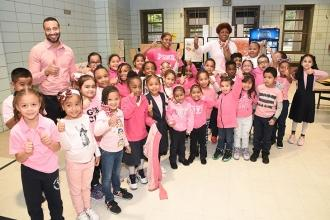 Students and teachers at PS 30 in Manhattan give breast cancer awareness a thumb