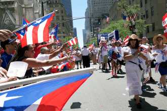Marchers wave Puerto Rican flags.