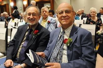The red roses signify that George Barabas (left) and Victor Beauchamp are proud