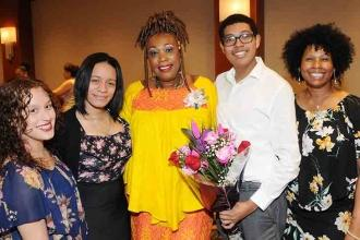 Joyce Parker (center) celebrates her Si Beagle Award with smiles and flowers fro