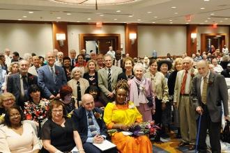 Retirees boasting 50- and 60-year UFT membership rise to be recognized.