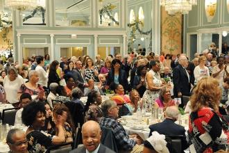 The record-breaking crowd of retirees make their way to their tables at the New