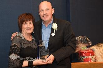 UFT President Michael Mulgrew presents the Celebration of Life Award to Mona Gon