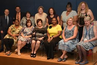 The School Secretaries Chapter Executive Board members take a photo together.