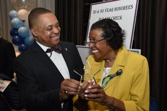 Florence King and her son, Gary King, share a smile over the award she received