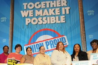 UFT members from PS 62 in the Bronx, another Jules Kolodny award winner, pose wi