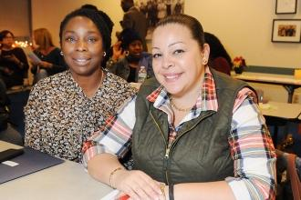 Monika Cummings (left) and Neysa Torres await the start of the meeting.