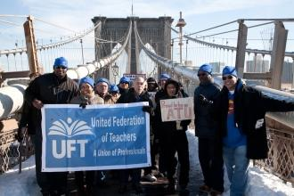 UFT members, including (front row, from left) Vice President Sterling Roberson,