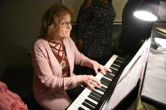 Pianist Barbara Haspel playing at the piano