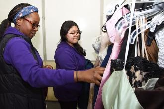 Nicole Price (left), a teacher at MS 319 in Queens, browses the racks with an 8t