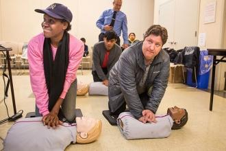 Parents Ella Felix (left) and Chad Vetsch attend a workshop to learn CPR.