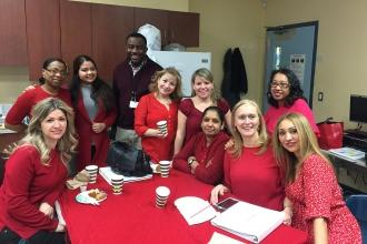 Educators in red at P 721 at Infotech in Queens.