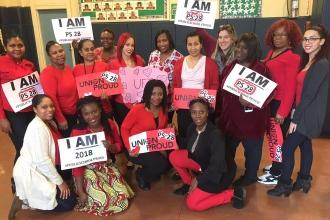Educators wear red at PS 28 in Bedford-Stuyvesant.
