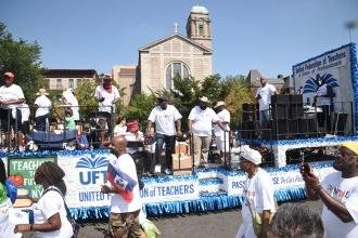 The UFT float and marchers make their way along the parade route.