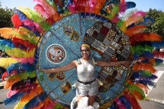 A parade participant shows off one of the many dazzling costumes.