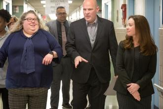 Staff gives President Mulgrew a tour of the building.