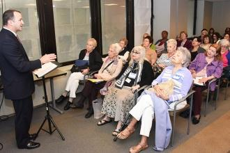 James Coll leads a roomful of retirees in the Madame Justice workshop.