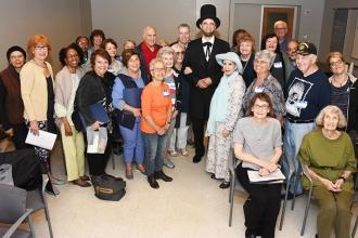 "Those attending the From Railsplitter to President workshop take a group shot with ""Honest Abe."""