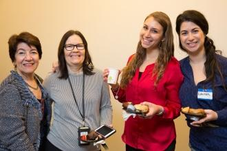 Four women pose for a photo at a conference for school counselors.