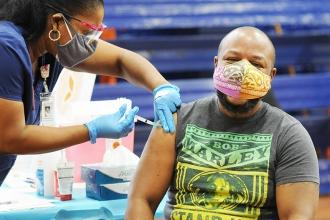 Teacher Garfield Reid of JHS 123 in the Bronx gets vaccinated