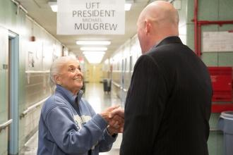 President Mulgrew is greeted by a staff member
